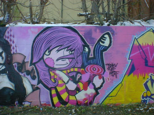 Cartoon girl graffiti with bloody cleaver, kitchen knife, and innocent smile