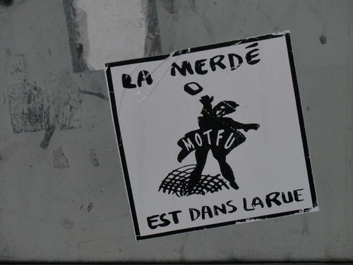 Sticker depicting anarchist reads: La Merde et dans la Rue