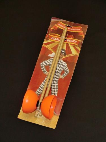 Diabolo toy packaging, showing Andrew in a harlequin outfit.