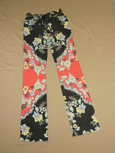 Red and black hipster jeans with a floral print.