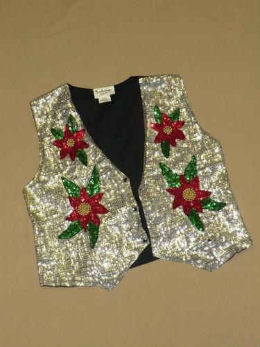 A sequined waistcoat, silver with red, green and gold flowers.