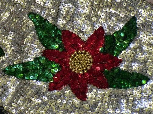 Flower design using red and green sequins, plus gold beads.