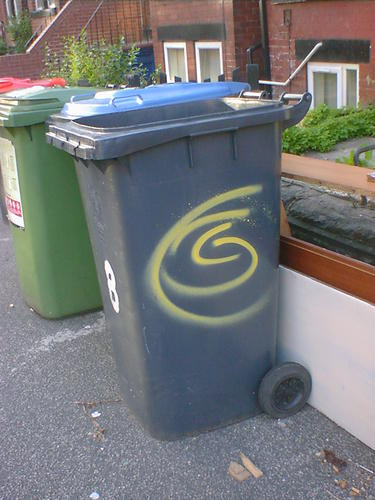 Yellow Spiral s[ray-paintes on a Wheelie Bin