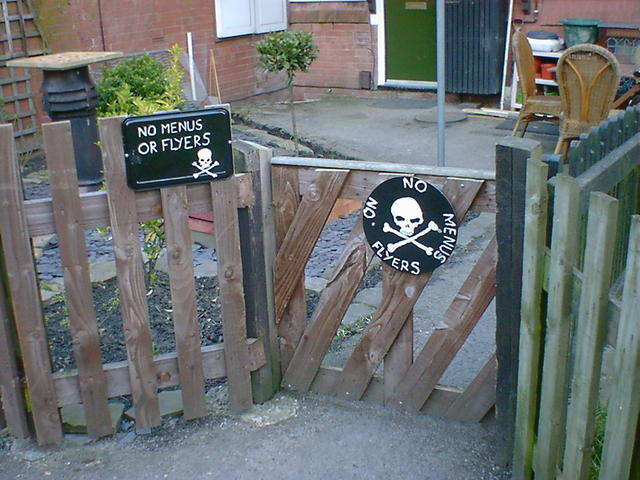 Two skull and crossbone warning signs: no menus or flyers!
