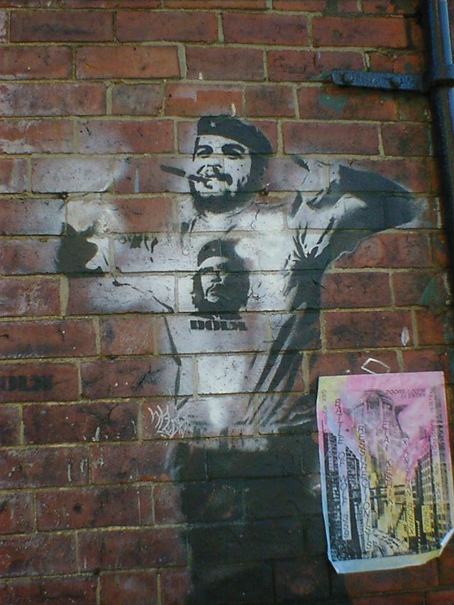 Stencil art of a bearded man in a beret, wearing a Ché Guevara t-shirt