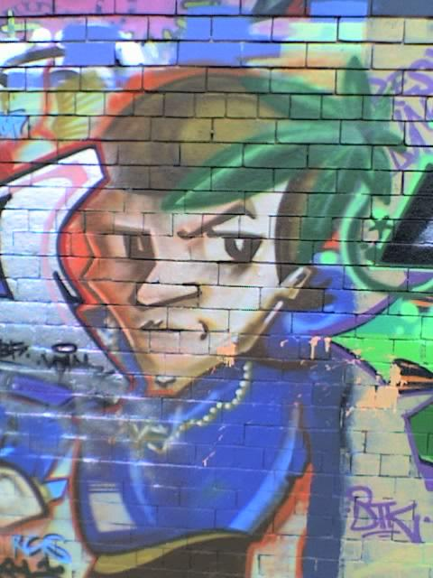 Graffiti art - a young man with a sharp haircut
