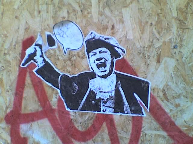 Wheatpaste sticker - a town crier, with an empty speech bubble.
