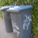 24 PT written on the side of a wheelie bin.