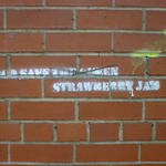 Stencilled grafitti reads: God Save Strawberry Jam