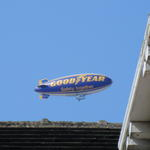 Photo of a Goodyear blimp above rooftop