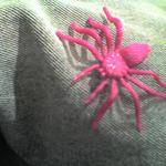 A bright pink plastic spider toy