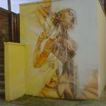Graffiti art - an abstract/nude woman, in orange and sienna.