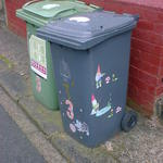 Gnome stickers decorating a wheelie bin