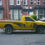 Yellow pickup truck with  Manga-style girl's eyes, painted on the side